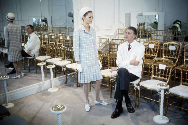 Hubert de Givenchy with a model wearing his design in 1969.  (INA via Getty Images)