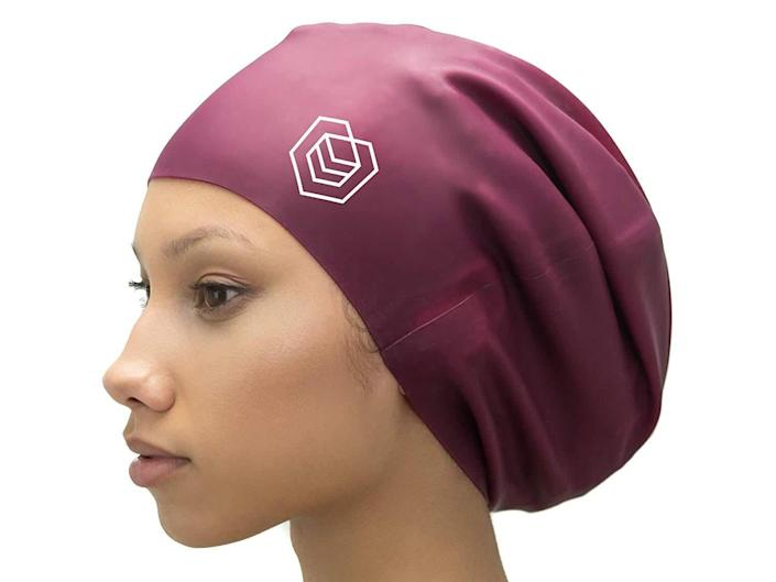 Keep afro hair tucked neatly away with this swim cap (Amazon)
