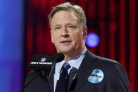 FILE - In this April 29, 2021, file photo, NFL commissioner Roger Goodell, wearing a COVID-19 vaccinated sticker, speaks during the first round of the NFL football draft in Cleveland. The NFL has informed teams they could potentially forfeit a game due to a COVID-19 outbreak among non-vaccinated players and players on both teams wouldn't get paid that week. Commissioner Goodell said Thursday, July 22, 2021, in a memo sent to clubs that was obtained by The Associated Press that the league doesn't anticipate adding a 19th week to accommodate games that can't be rescheduled within the 18-week regular season. (AP Photo/Steve Luciano)