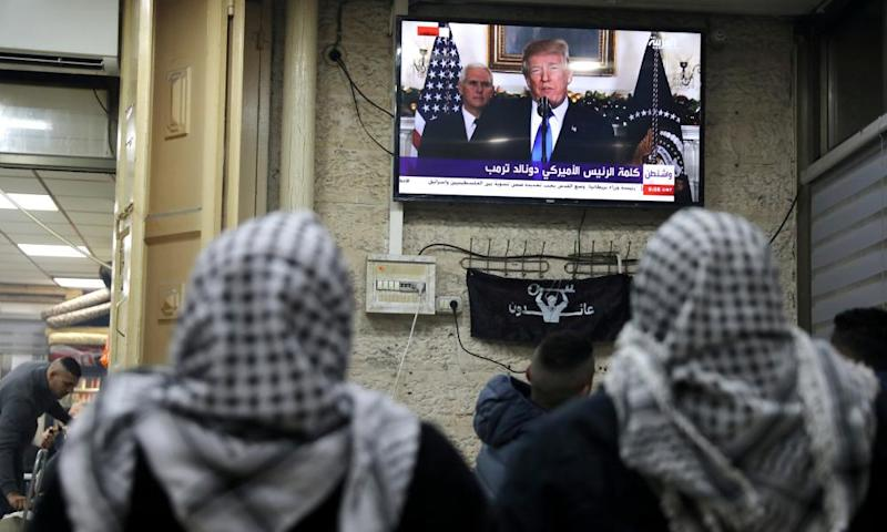 Palestinians watch a televised broadcast of Trump announcing US recognition of Jerusalem as the capital of Israel, in Jerusalem's Old City.