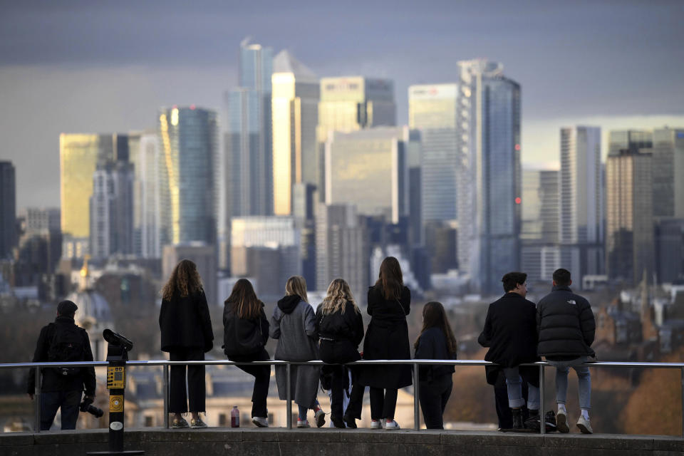People look out over the city of London, from Greenwich Park in London. Photo: Stefan Rousseau/PA via AP
