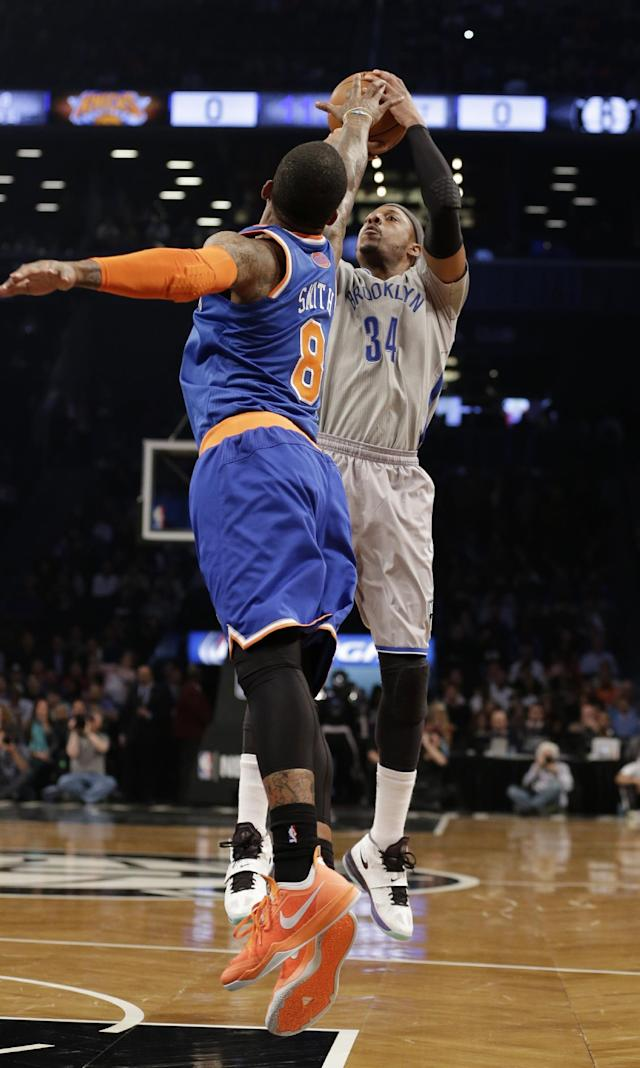 Brooklyn Nets' Paul Pierce (34) shoots over New York Knicks' J.R. Smith (8) during the first half of an NBA basketball game Tuesday, April 15, 2014, in New York. (AP Photo/Frank Franklin II)