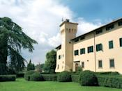 """Not your average Tuscan estate, this 12th-century castle wedged deep into the Chianti countryside 40 minutes south of <a href=""""https://www.cntraveler.com/destinations/florence?mbid=synd_yahoo_rss"""" rel=""""nofollow noopener"""" target=""""_blank"""" data-ylk=""""slk:Florence"""" class=""""link rapid-noclick-resp"""">Florence</a>, is COMO's first property in mainland Europe. And what a place: what used to be a flouncy Italianate hotel has been transformed into a thoroughly modern, city-sleek pad with brooding gray and putty-colored walls paired with eau-de-nil armchairs and the odd jade patio door. COMO's highlights are its spas, of course, and this one doesn't disappoint, with signature COMO Shambhala treatments, Guinot facials, and an outdoor pool in the summer season (when there's also outdoor yoga, overlooking the rolling hills). At Michelin-starred restaurant La Torre, executive chef Giovanni Luca Di Pirro works his magic on local ingredients; pre-game with an oil or wine tasting in the medieval wine cellars."""