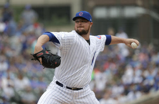 Chicago Cubs starting pitcher Jon Lester delivers during the first inning of a baseball game against the Los Angeles Dodgers Wednesday, June 20, 2018, in Chicago. (AP Photo/Charles Rex Arbogast)