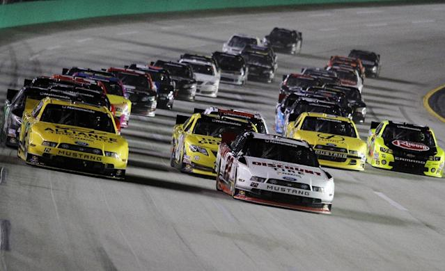 Ryan Blaney (22) leads Sam Hornish Jr., left, during an early lap of the NASCAR Nationwide Series auto race, Saturday, Sept. 21, 2013, at Kentucky Motor Speedway in Sparta, Ky. (AP Photo/James Crisp)