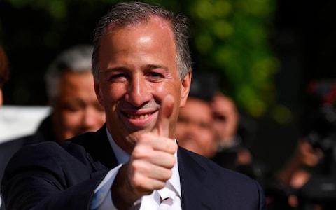 <span>Jose Antonio Meade gives a thumbs up after voting on Sunday. He was the first to concede defeat</span> <span>Credit: AFP </span>