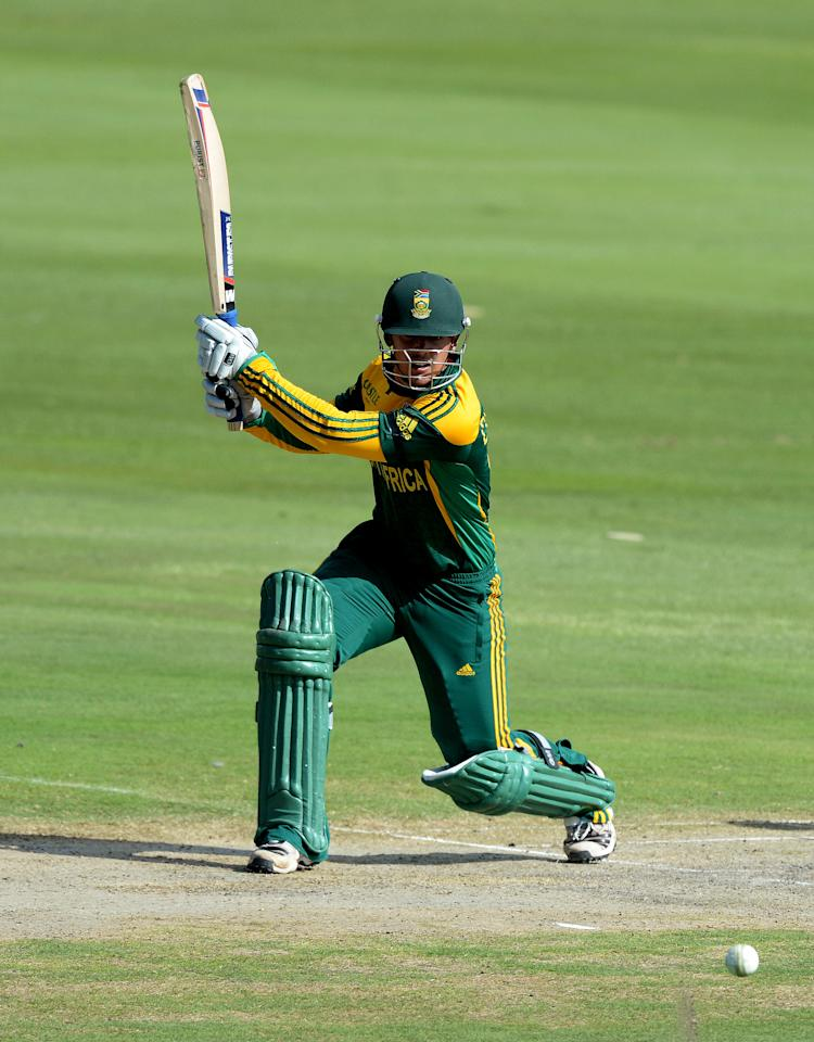 CENTURION, SOUTH AFRICA - DECEMBER 11: Quinton de Kock of South Africa drives through the covers during the 3rd Momentum ODI match between South Africa and India at SuperSport Park on December 11, 2013 in Centurion, South Africa. (Photo by Duif du Toit/Gallo Images/Getty Images)