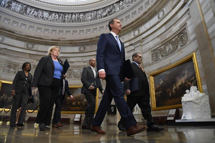 House Intelligence Committee Chairman Adam Schiff, D-Calif., right, leads the group of impeachment managers through the rotunda on their way to the Senate on Jan. 16, 2020.