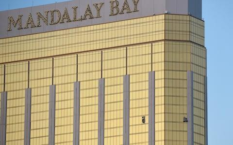 Broken windows on the 32nd floor of the Mandalay Bay hotel, where Paddock amassed an arsenal of 20 guns - Credit: David Becker/Getty Images