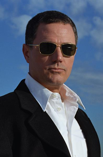 """FIL - In this photo released by Simon and Schuster shows author Robert Crais. """"I live and die with the Duke Blue Devils,' Crais told AP national writer Hillel Italie. (AP Photo/Julie Brothers,Simon and Schuster,File)"""
