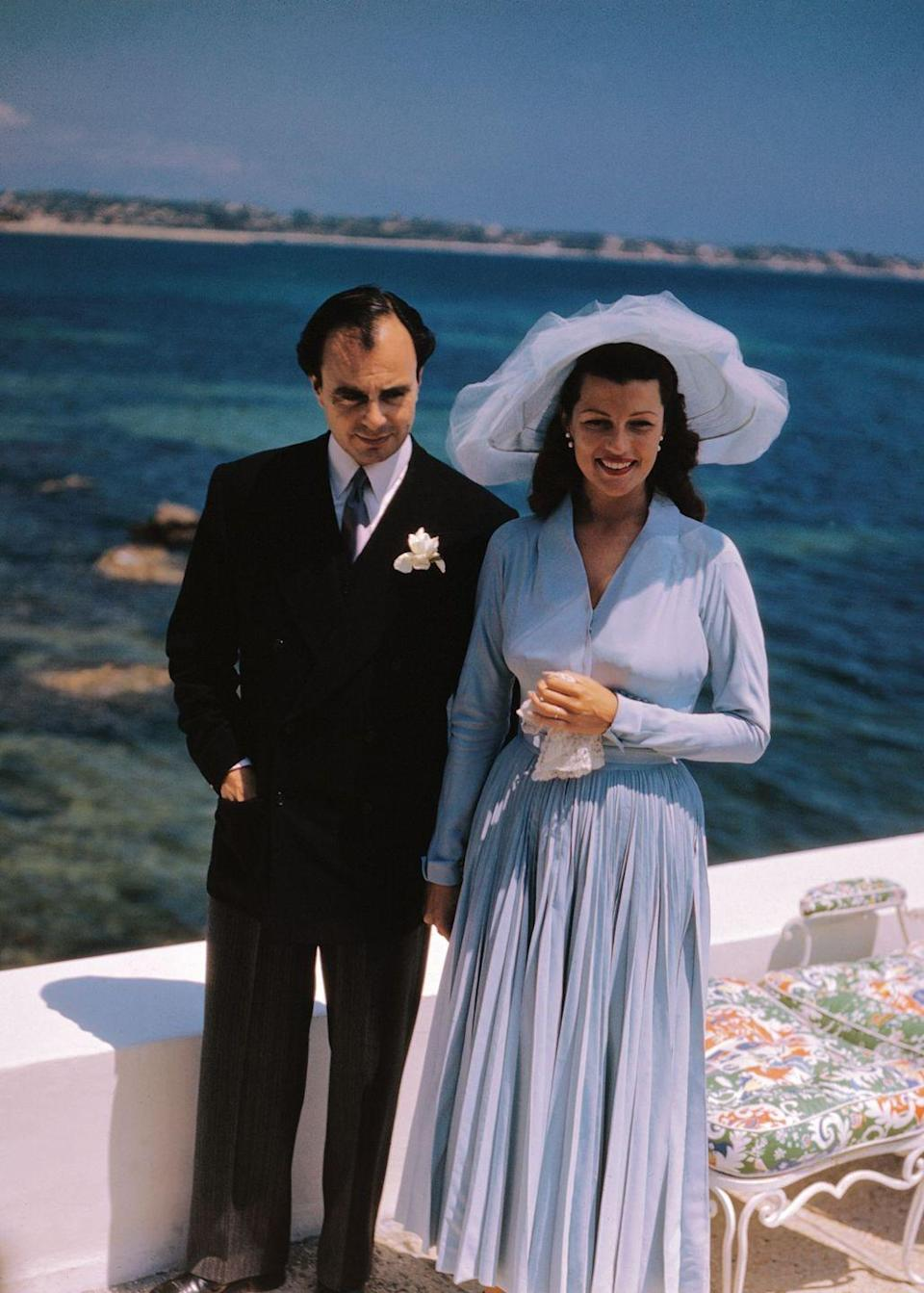 <p>Leaving her film career behind to marry Prince Aly Khan—a son of Sultan Muhammed Shah, Aga Khan III—Rita Hayworth found inspiration in Christian Dior's 1947 New Look collection. Her third wedding dress embodied Dior's classic elegance with its small bust and long, ample skirt.</p>