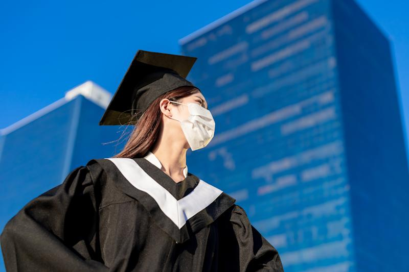 Depressed asian female graduate student wear mask and she can not find job due to covid-19 spread all over the world