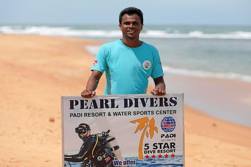 Nuwan Harshana, 31, manager at Pearl Divers, a diving school, poses for a photograph during an interview with Reuters, near his hotel at Unawatuna beach in Galle, Sri Lanka July 4, 2019. REUTERS/Dinuka Liyanawatte