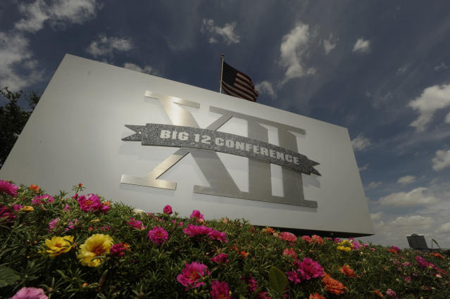 FILE - In this June 14, 2010, file photo, a Big 12 sign is seen outside the conference headquarters in Irving, Texas. The coronavirus pandemic has shuttered sports at all levels, but all Big 12 schools expect their campuses to be open in the fall, lending hope to the possibility that football can start on time. (AP Photo/Cody Duty, File)