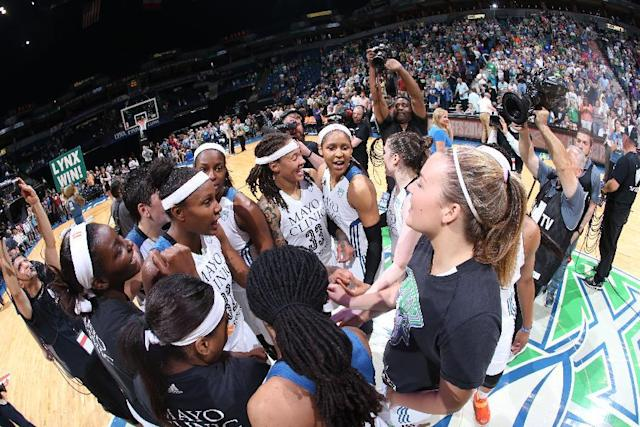 MINNEAPOLIS, MN - AUGUST 21: Rebekkah Brunson #32 Devereaux Peters #14 Janel McCarville #4 Seimone Augustus #33 Maya Moore #23 Lindsay Whalen #13 of the Minnesota Lynx celebrate the win against the San Antonio Stars after Game One of the Western Conference Semifinals during the 2014 WNBA Playoffs on August 21, 2014 at Target Center in Minneapolis, Minnesota. (Photo by David Sherman/NBAE via Getty Images)