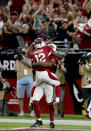 Arizona Cardinals wide receiver John Brown (12) celebrates his touchdown with teammate Larry Fitzgerald during the second half of an NFL football game against the St. Louis Rams, Sunday, Nov. 9, 2014, in Glendale, Ariz. (AP Photo/Ross D. Franklin)
