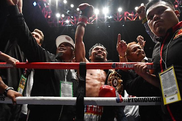 Manny Pacquiao is hoping to open a new chapter in his long career. (AFP Photo/Mohd RASFAN)