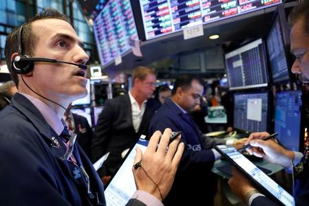 Stocks fall, dollar rises as investors worry about trade