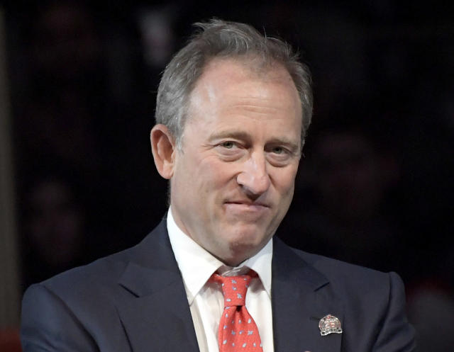 FILE - In this Feb. 24, 2018, file photo, Josh Harris is shown during ceremonies before a hockey game in Newark, N.J. The New Jersey Devils and Philadelphia 76ers have done an about-face on cutting salaries for employees making more than $100,000. A day after announcing the temporary 20% pay cuts because of the economics effects of the coronavirus pandemic, the teams' co-owners rescinded them. Co-owner Josh Harris says after listening to his staff and players, its clear that the pay cuts was the wrong decision. (AP Photo/Bill Kostroun, File)