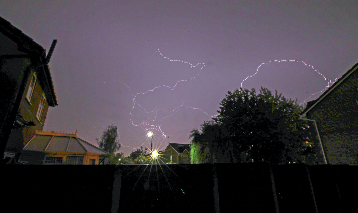 Dazzling lightning displays over houses in Lee Park, Liverpool, Merseyside. (PA)