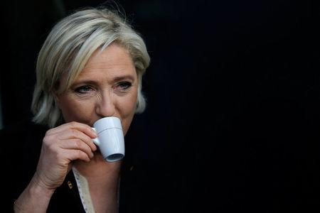 Marine Le Pen, French National Front (FN) political party leader and candidate for French 2017 presidential election, drinks a coffee after a visit to a market in Concarneau