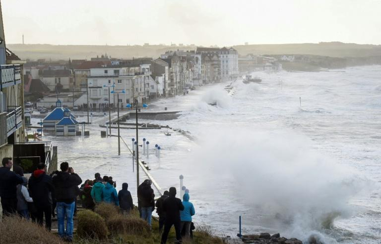 A crowd watched as massive waves flooded the seafront of Wimereux, northern France, on Wednesday