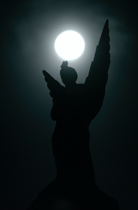 "<p>The moon at its fullest in the middle of the night behind the Angel statue on the Paisley Road Toll 'Angel Building' above ""La Fiorentina"" Italian restaurant in Glasgow, Scotland. (PA) </p>"