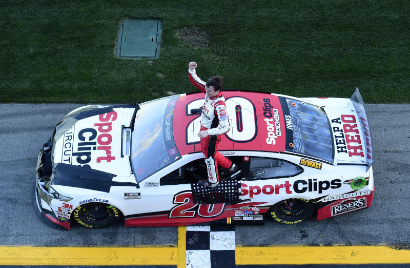 DAYTONA BEACH, FLORIDA - FEBRUARY 09: Erik Jones, driver of the #20 Sport Clips Toyota, celebrates winning the NASCAR Cup Series Busch Clash at Daytona International Speedway on February 09, 2020 in Daytona Beach, Florida. (Photo by Jared C. Tilton/Getty Images)