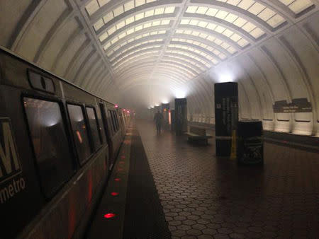 The Woodley Park Metro station in Washington, DC is shown filling with smoke in this handout photo taken February 21, 2015, provided by Liz Palka. REUTERS/Liz Palka/Handout