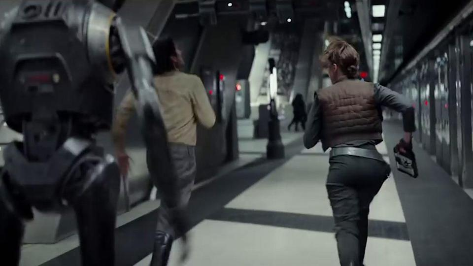 <p>This scene was shot in Canary Wharf Tube station, and seems to be part of the same sequence with Jyn, Cassian, and K2SO escaping with plans – you can see them in her hand here. Credit: Lucasfilm/Disney </p>
