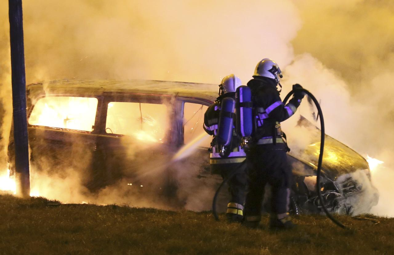 ZAVENTEM , BELGIUM - FEBRUARY 18: (BELGIUM OUT , FRANCE OUT , NETHERLANDS OUT) Firemen extinguish the burnt out remains of the van used in the heist near Brussels Airport on February 18, 2013 in Zaventem, Belgium. Using a van and car to break down the security fence a gang of robbers stole diamonds estimated to be worth 50 Million Euros from a security van. (Photo by Mozkito/Photonews via Getty Images)