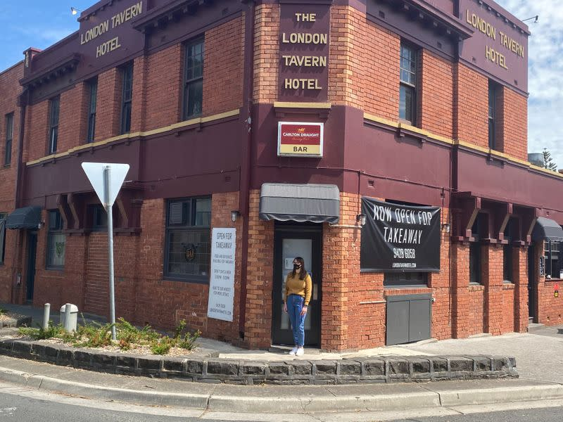 FILE PHOTO: Gina Cimarosti, manager of the London Tavern Hotel, stands outside her empty pub in Melbourne
