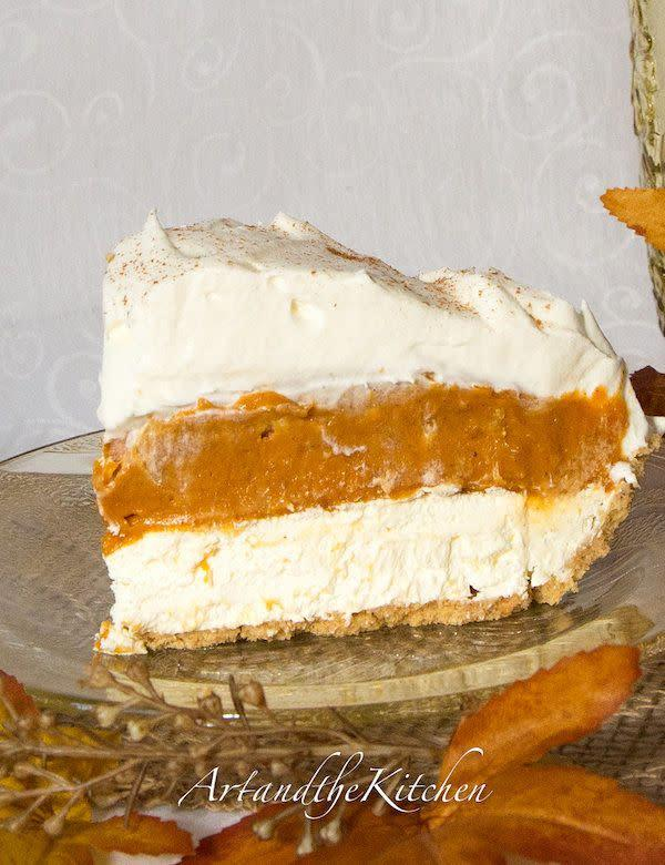 """This pie may look fancy, but in fact, it could be the easiest and fastest pumpkin pie you ever make. <a href=""""http://www.artandthekitchen.com/2013/09/no-bake-triple-layer-pumpkin-pie.html"""" rel=""""nofollow noopener"""" target=""""_blank"""" data-ylk=""""slk:Find the recipe at Art and the Kitchen"""" class=""""link rapid-noclick-resp"""">Find the recipe at Art and the Kitchen</a>."""