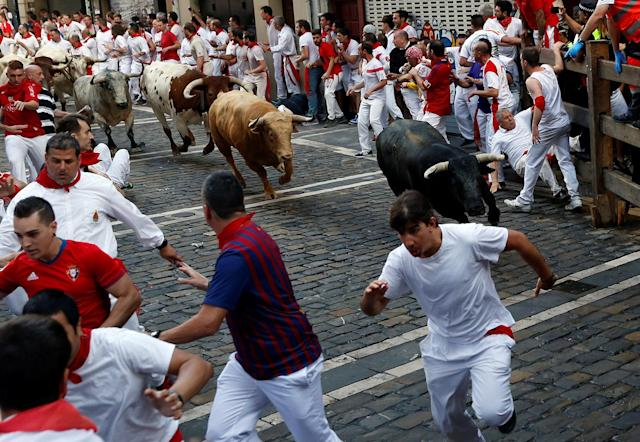 <p>Runners sprint ahead of bulls during the first running of the bulls at the San Fermin festival in Pamplona, northern Spain, July 7, 2017. (Susana Vera/Reuters) </p>