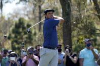 Bryson DeChambeau watches his tee shot on the ninth hole during the second round of the The Players Championship golf tournament Friday, March 12, 2021, in Ponte Vedra Beach, Fla. (AP Photo/John Raoux)