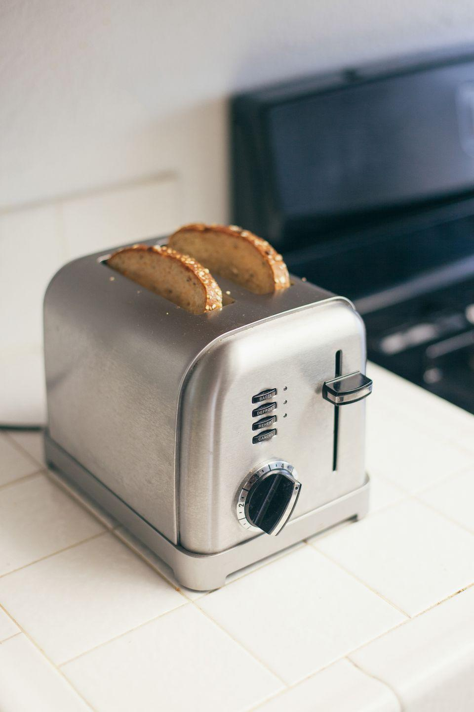 "<p>According to The Kitchn, <a href=""https://www.thekitchn.com/how-to-clean-the-toaster-cleaning-lessons-from-the-kitchn-74452"" rel=""nofollow noopener"" target=""_blank"" data-ylk=""slk:you should start with the crumb tray"" class=""link rapid-noclick-resp"">you should start with the crumb tray</a> when cleaning out your toaster. After making sure your appliance is unplugged, wash and dry your toaster's crumb tray, using a small pastry or basting brush to get into the hard-to-reach corners. Once finished, you can replace the tray. </p><p>To clean the toaster's exterior, wipe it down with a damp cloth and gentle soap. If your toaster is stainless steel, you can use a bit of vinegar to make it shine. </p>"