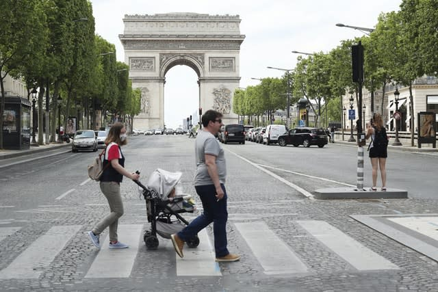 People stroll on the Champs Elysees (Thibault Camus/AP)