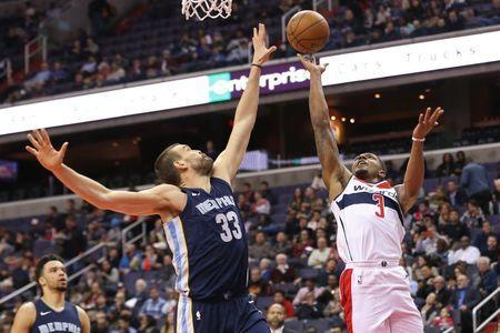 Dec 13, 2017; Washington, DC, USA; Washington Wizards guard Bradley Beal (3) shoots the ball as Memphis Grizzlies center Marc Gasol (33) defends in the third quarter at Capital One Arena. The Wizards won 93-87. Geoff Burke-USA TODAY Sports