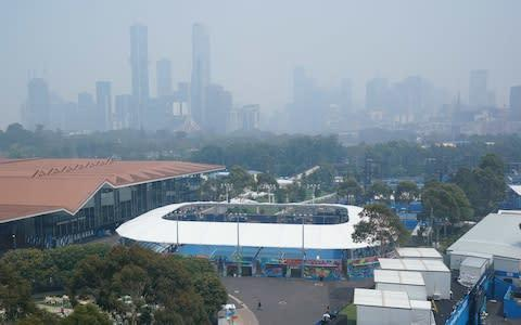 <span>Haze covers the skyline during practice sessions at the Australian Open</span> <span>Credit: Rex </span>