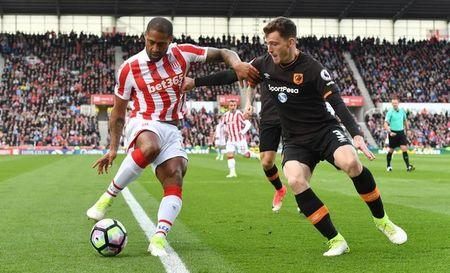 Stoke City's Glen Johnson in action with Hull City's Andrew Robertson