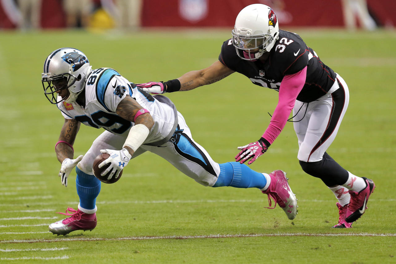 Carolina Panthers wide receiver Steve Smith (89) is knocked down by Arizona Cardinals free safety Tyrann Mathieu (32) during the second half of an NFL football game on Sunday, Oct. 6, 2013, in Glendale, Ariz. (AP Photo/Ross D. Franklin)
