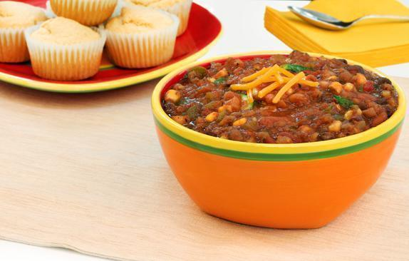 """<p>This chili is <a href=""""https://www.thedailymeal.com/cook/50-vegetarian-recipes-meatless-mondays-or-any-other-time-slideshow?referrer=yahoo&category=beauty_food&include_utm=1&utm_medium=referral&utm_source=yahoo&utm_campaign=feed"""" rel=""""nofollow noopener"""" target=""""_blank"""" data-ylk=""""slk:vegetarian"""" class=""""link rapid-noclick-resp"""">vegetarian</a>, but it's still packed with flavor and protein.</p> <p><a href=""""https://www.thedailymeal.com/best-recipes/vegetarian-bean-chili?referrer=yahoo&category=beauty_food&include_utm=1&utm_medium=referral&utm_source=yahoo&utm_campaign=feed"""" rel=""""nofollow noopener"""" target=""""_blank"""" data-ylk=""""slk:For the Three Bean Vegetarian Chili recipe, click here"""" class=""""link rapid-noclick-resp"""">For the Three Bean Vegetarian Chili recipe, click here</a>.</p>"""