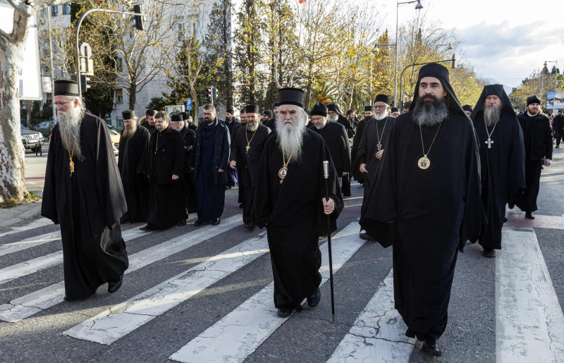 Serbian Orthodox Church clergy in Montenegro march as they protest the planned adoption of a religious law that they say will pave the way to strip the church of its property, in Podgorica, Montenegro, Tuesday, Dec. 24, 2019. Montenegro's pro-Western president has accused the church of promoting pro-Serb policies in Montenegro and seeking to undermine the country's statehood since it split from Serbia in 2006. (AP Photo/Risto Bozovic)
