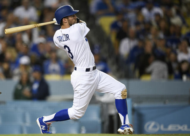 Los Angeles Dodgers left fielder Chris Taylor follows through on a swing for a solo home run during the fifth inning of a baseball game against the San Francisco Giants in Los Angeles, Monday, April 1, 2019. (AP Photo/Kelvin Kuo)