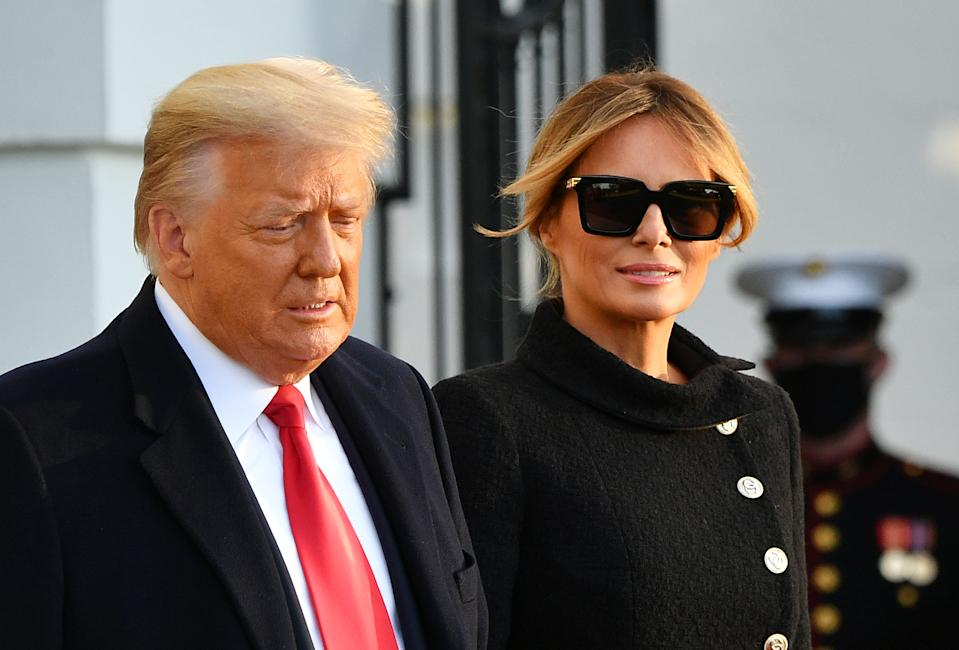 US President Donald Trump and First Lady Melania Trump make their way to board Marine One as they depart the White House in Washington, DC, on January 20, 2021. - President Trump travels to his Mar-a-Lago golf club residence in Palm Beach, Florida, and will not attend the inauguration for President-elect Joe Biden. (Photo by MANDEL NGAN / AFP) (Photo by MANDEL NGAN/AFP via Getty Images)