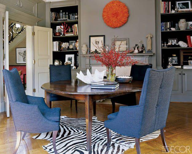 "<p>Ali Wentworth and George Stephanopolous know the key to an inviting dining room: a statement rug. The actress and her news-anchor husband chose a striking zebra print rug for the dining space in their colorful D.C. home. <a href=""http://www.rjones.com/"" target=""_blank"">RJones</a> chairs, an antique dining table from <a href=""http://www.lizashermanantiques.com/"" target=""_blank"">Liza Sherman Antiques</a>, and an African headdress purchased at a flea market complete the look. </p>"