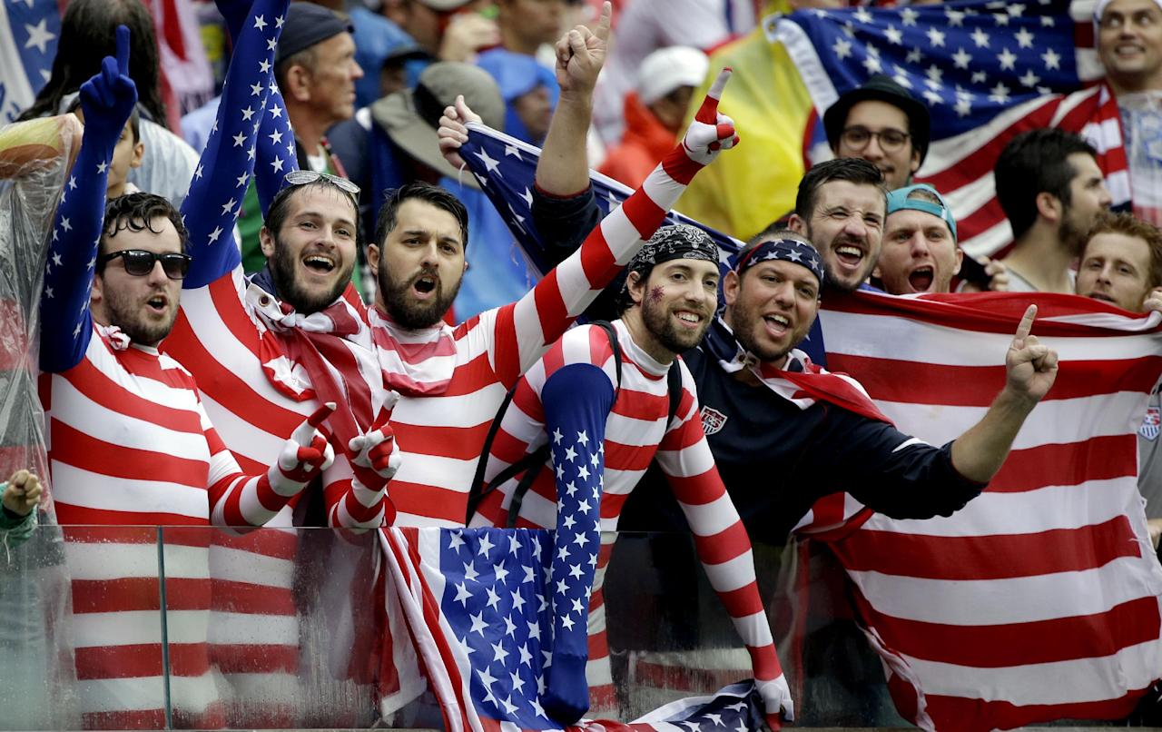 USA supporters cheer for their national team during the group G World Cup soccer match between the USA and Germany at the Arena Pernambuco in Recife, Brazil, Thursday, June 26, 2014. (AP Photo/Ricardo Mazalan)