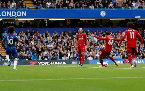 Liverpool's Trent Alexander-Arnold, second from right, scores his side's opening goal on a free kick, during the British Premier League soccer match between Chelsea and Liverpool, at the Stamford Bridge Stadium, London, Sunday, Sept. 22, 2019 - Credit: AP