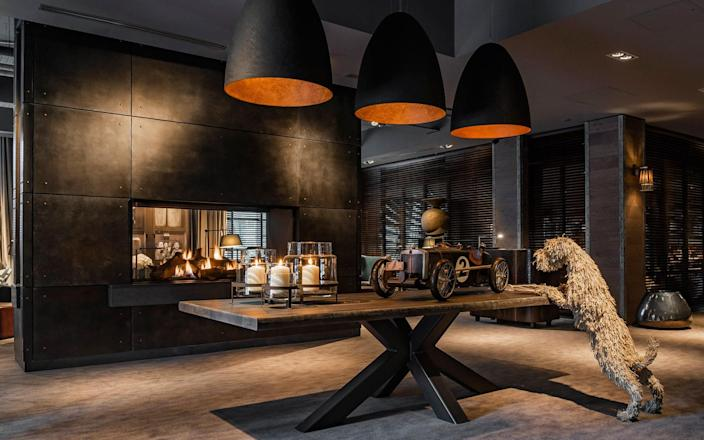 The interiors at the Dakota are characterised by oversized light fittings, warm metallics, interesting objects – and lots of black