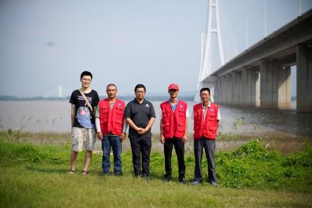Conservationists pose for picture at the Yangtze river near the city of Nanjing